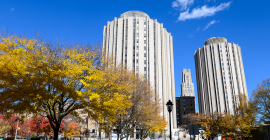 Litchfield Towers in the fall, with a view of the Cathedral of Learning in between 2 towers.
